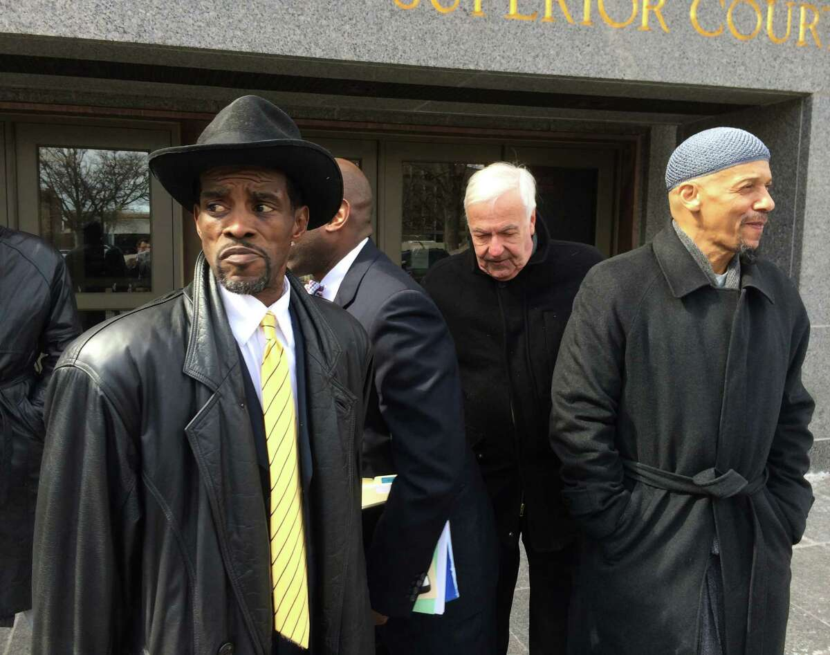 Former State Sen. Ernie Newton leaves Hartford Superior Court with supporters Charles Coviello center and Lyle Hassan Jones. Newton was sentenced on Friday, March 13, 2014 to prison for 6 months as a result of baiting state campaign financing laws.