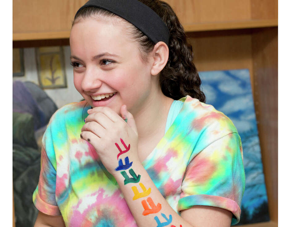 Kayla Wallet, a junior at Masuk High School, laughs as she recites a cheer celebrating Pi at Masuk High School on Friday, Mar. 13, 2015. On Friday, March 13th, in honor of the Pi Day of the century, the students in Mari O'Rourke's PreCalculus Honors classes hosted a Pi themed extravaganza for the math classes at Masuk High School in Monroe on Friday, Mar. 13, 2015. Photo: Amy Mortensen / Connecticut Post Freelance
