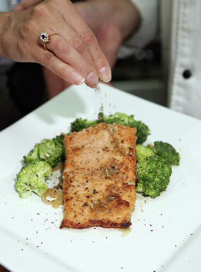Wild salmon is a good source of Omega-3 fatty acids. Photo: HECTOR GABINO, MBR / Miami Herald