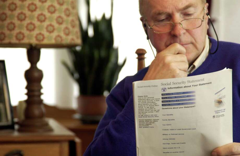 Senior man reading Social Security form Photo: Jim McGuire / Getty Images / (c) Jim McGuire