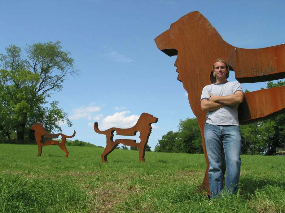 """Artist Dale Rogers with """"Big Dogs."""" Photo: Johnson Development"""