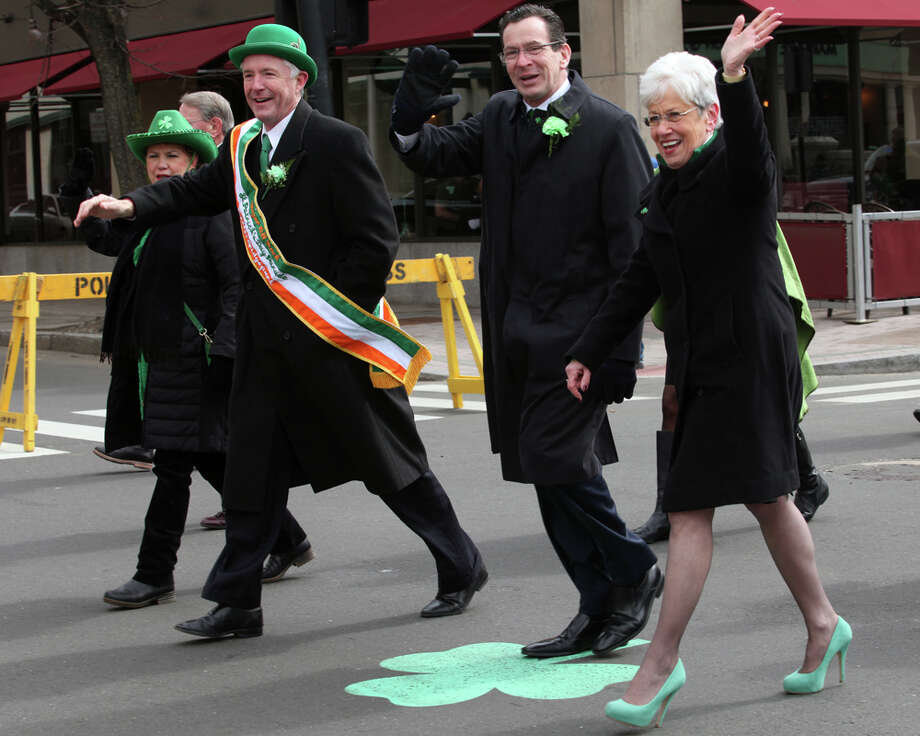 Politicians, from left, Mayor Bill Finch, Gov. Dannel Malloy, and Lt. Governor Nancy Wyman,  adorn green in the Greater Bridgeport 32nd St.Patrick's Day Parade in downtown Bridgeport, Conn. on Monday, March 17, 2014. Photo: BK Angeletti, B.K. Angeletti / Connecticut Post freelance B.K. Angeletti