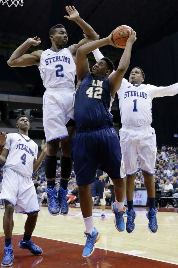 La Marque's LaDerrious Arvie (42) is pressured by Houston Sterling's Curglon Wesley (2) and Avery Ragland (1) during a UIL boys' 4A basketball state semifinal game, Friday, March 13, 2015, in San Antonio. Houston Sterling won 66-57. (AP Photo/Eric Gay) Photo: Eric Gay, Associated Press / AP
