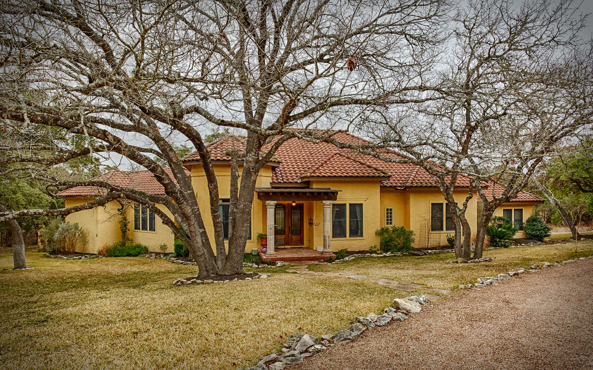 One of the Hill Country-area properties listed by The Graves Group is this stunning home at 27622 Ranch Creek in the Highlands Ranch community in Boerne.