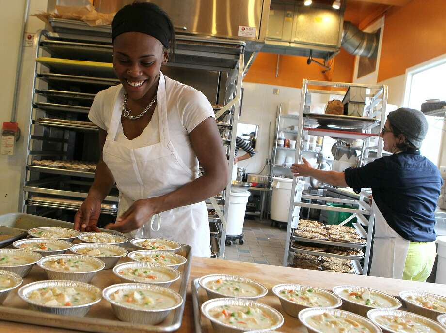 Food prep Raytrina Johnson (left) makes chicken pot pies at Mission Pie as Krystin Rubin, the stores co-owner moves a pie cart. Photo: Santiago Mejia, The Chronicle