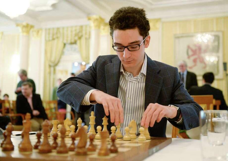 Grandmaster Fabiano Caruana prepares to battle Japanese grandmaster Hikaru Nakamura in the 2015 Zurich Chess Challenge in Switzerland on Saturday.  Photo: Steffen Schmidt, SUB / KEYSTONE