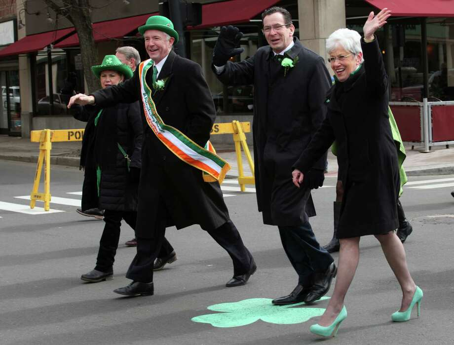 Politicians, from left, Mayor Bill Finch, Gov. Dannel Malloy, and Lt. Governor Nancy Wyman,  adorn green in the Greater Bridgeport 32nd St.Patrick's Day Parade in downtown Bridgeport, Conn. on Monday, March 17, 2014. Photo: BK Angeletti, B.K. Angeletti / Connecticut Post