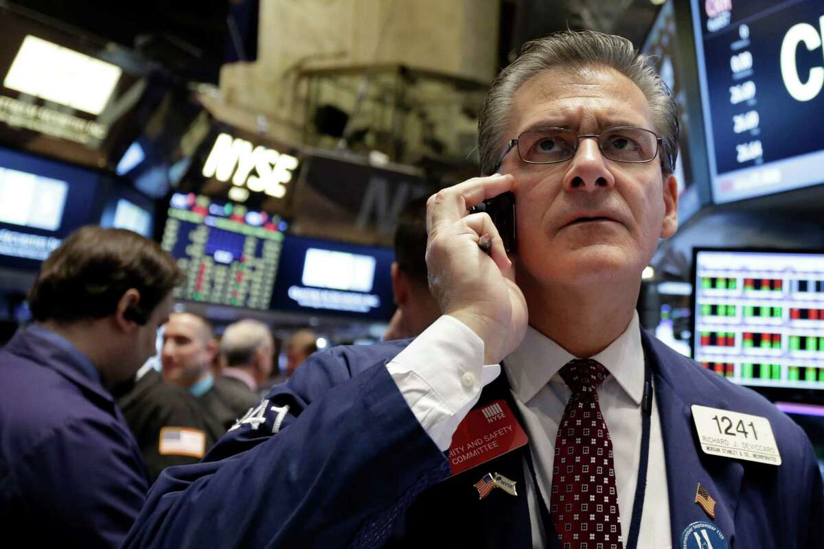 Trader Richard Deviccario works on the floor of the New York Stock Exchange. (AP Photo/Richard Drew) ORG XMIT: NYRD102