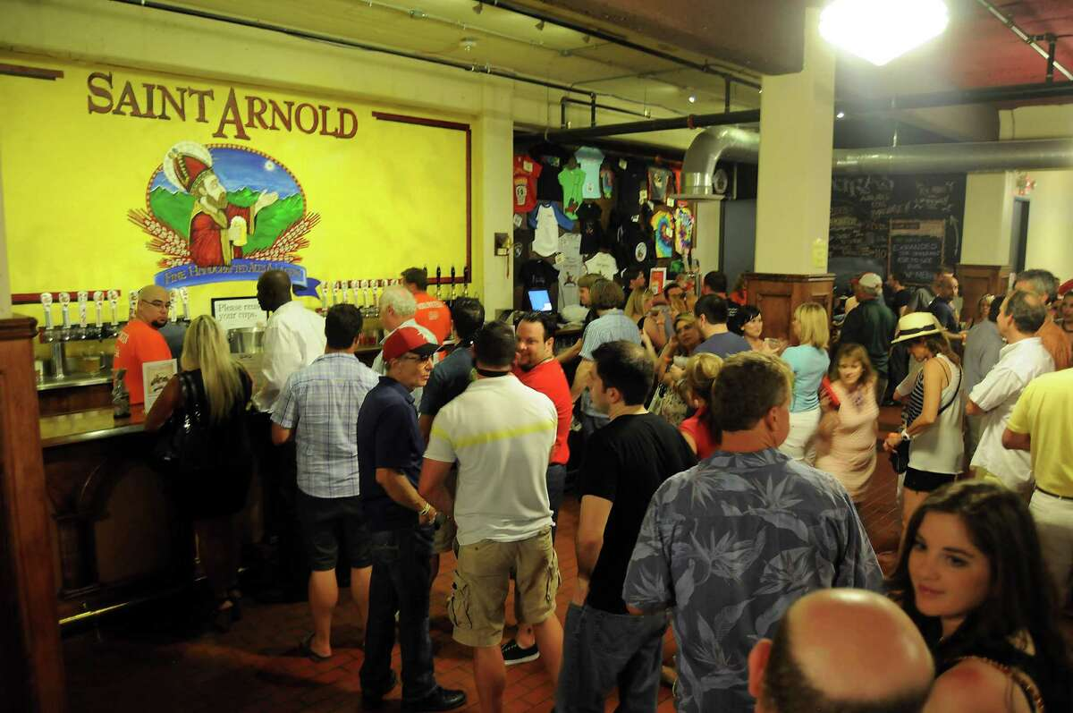 Guests wait for pints at Saint Arnold Brewing Co. Brock Wagner, owner of Saint Arnold Brewing Co., says craft brewers are not seeking to replace traditional retailers.