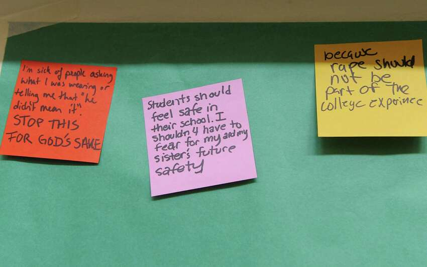 Sticky notes are seen on a wall during a silent rally to protest a college readmission hearing for a male student who received a one-year suspension for sexually assaulting Skidmore College student Reina Keifer at Skidmore College on Friday, March 13, 2015 in Saratoga Springs, N.Y. (Lori Van Buren / Times Union)