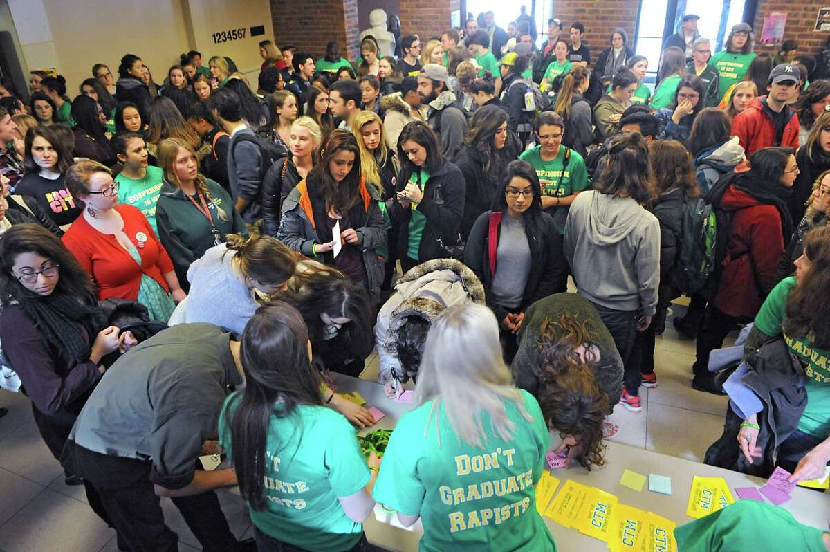 Hundreds of students show up for a silent rally to protest a college readmission hearing for a male student who received a one-year suspension for sexually assaulting Skidmore College student Reina Keifer at Skidmore College on Friday, March 13, 2015 in Saratoga Springs, N.Y. (Lori Van Buren / Times Union)