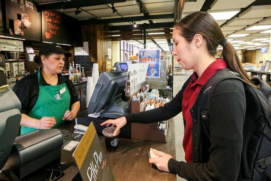 Baristias at Starbucks across the Bay Area may soon be serving beer and wine along with their assortment of coffee and tea drinks. Photo: Marvin Pfeiffer, San Antonio Express-News