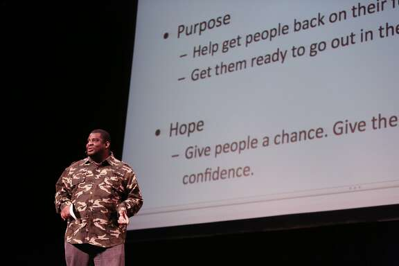 Arondo Washington Cox talked about Camp Unity, a sanctioned homeless encampment, where he lives in Seattle at Nourse Auditorium on Wednesday, March 11, 2015.