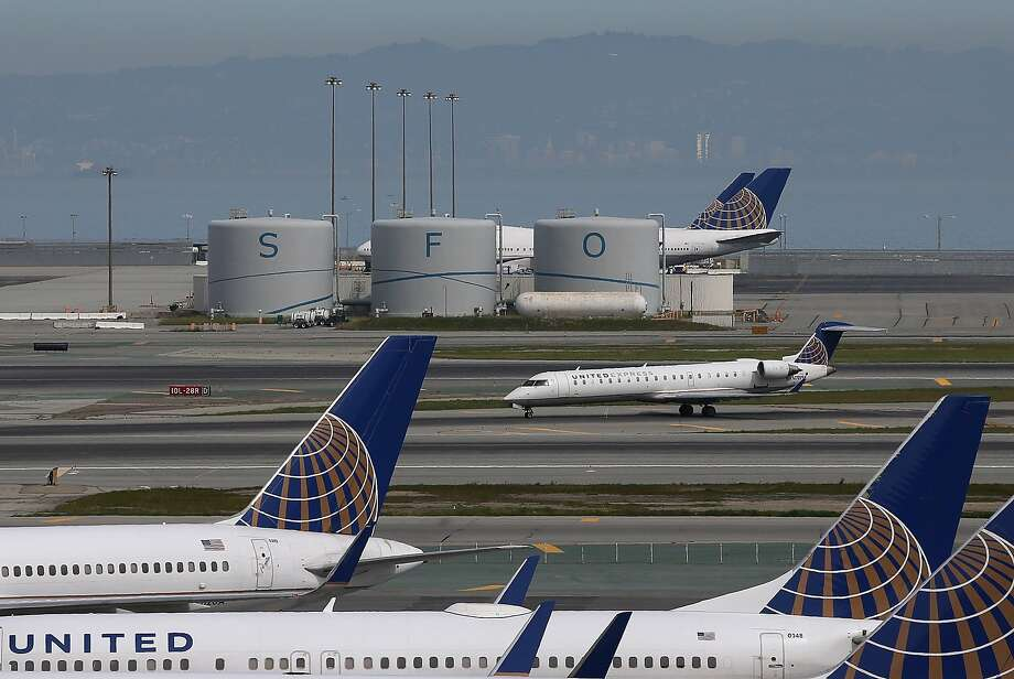 Planes sit on a runway at San Francisco International Airport on Friday. Photo: Justin Sullivan, Getty Images