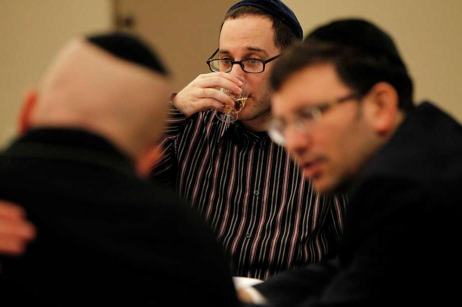 Imanuel Fayn, 29, drinks a glass of wine during a a kosher wine-tasting event at Congregation Emanu El, Thursday, March 12, 2015, in Houston. ( Karen Warren / Houston Chronicle  ) Photo: Karen Warren, Staff / © 2015 Houston Chronicle