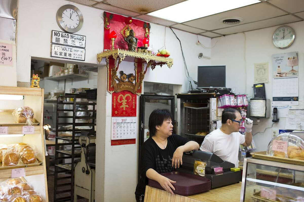Sandy Vuong, the owner of the Princess Bakery, stands by the cash register waiting for customers in Chinatown in Oakland.