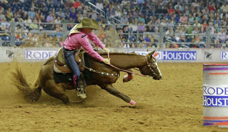 Kelley Carrington rides in the barrel racing event during RodeoHouston at the Houston Livestock Show and Rodeo in NRG Stadium Wednesday, March 4, 2015, in Houston. Her horse stumbled near the first barrel. Photo: Melissa Phillip, Houston Chronicle / © 2014  Houston Chronicle