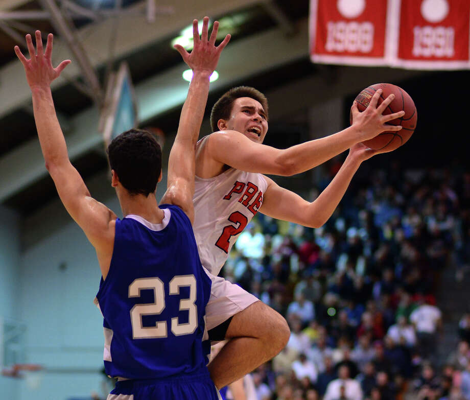 Fairfield Prep's Matthew Gerics looks to score in front of Fairfield Ludlowe defender Chad Peterson, during Class LL Boys' Basketball tournament action in Fairfield, Conn. on Friday Mar. 13, 2015. Photo: Christian Abraham / Connecticut Post