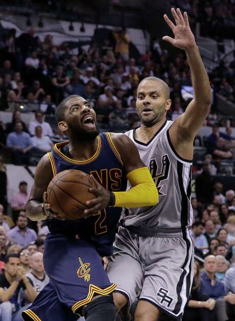 Cavaliers guard Kyrie Irving, left, burned Tony Parker and the Spurs' defense for a franchise-record 57 points. Photo: Eric Gay, STF / AP