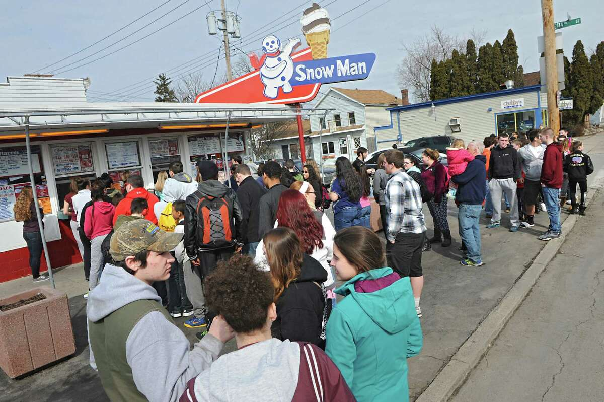 The Snow Man on 5th Ave. draws hundreds of people on opening day on Friday, March 13, 2015 in Troy, N.Y. (Lori Van Buren / Times Union)