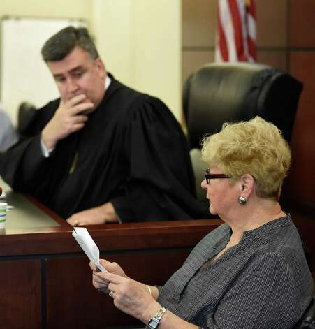 Judge Roger McDonough listens as Carol LeBoissiere gives her victim impact statement during the sentencing of Christina Yerry at the Judicial Center Friday morning, March 13, 2015, in Albany, N.Y. She was sentenced to state prison Friday for stealing more than $200,000 from a 72-year-old neighbor in Watervliet. (Skip Dickstein/Times Union) Photo: SKIP DICKSTEIN / 00031007A
