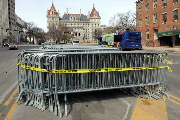 Barricade for the Saturday Albany St. Patrick's parade sit ready in the middle of State Street  Friday, March 13, 2015, in Albany, N.Y.  (Michael P. Farrell/Times Union) Photo: Michael P. Farrell / 00031029A