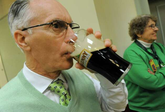 Dave Stack enjoys a sip of Guinness during the Green Tie Luncheon at the Capital District Irish America Association to kick off St. Patrick's Day festivities on Friday, March 13, 2015, in Albany, N.Y.  (Michael P. Farrell/Times Union) Photo: Michael P. Farrell / 00030898A