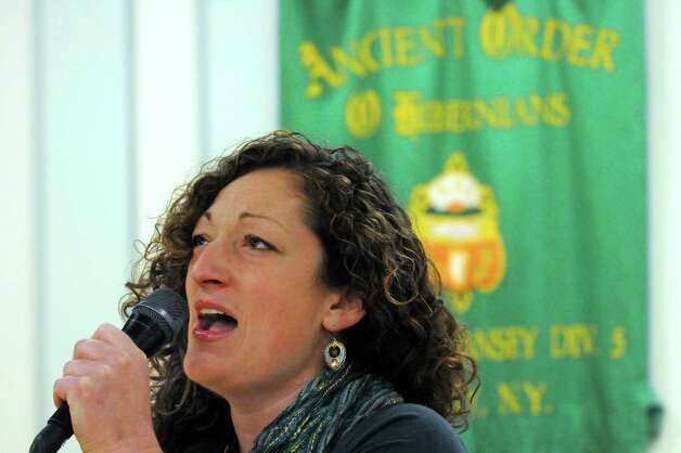 "Jenny O'Connell of Albany sings the ""The Star-Spangled Banner"" to begin the Green Tie Luncheon at the Capital District Irish America Association to kick off St. Patrick's Day festivities on Friday, March 13, 2015, in Albany, N.Y.  (Michael P. Farrell/Times Union) Photo: Michael P. Farrell / 00030898A"