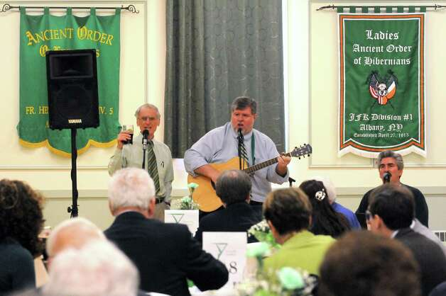 The Three Irish Voices perform during the Green Tie Luncheon at the Capital District Irish America Association to kick off St. Patrick's Day festivities on Friday, March 13, 2015, in Albany, N.Y.  (Michael P. Farrell/Times Union) Photo: Michael P. Farrell / 00030898A