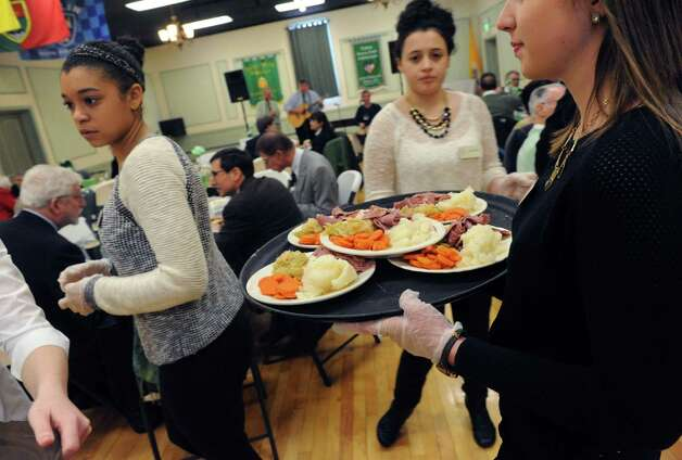 Corned beef and cabbage are served during the Green Tie Luncheon at the Capital District Irish America Association to kick off St. Patrick's Day festivities on Friday, March 13, 2015, in Albany, N.Y.  (Michael P. Farrell/Times Union) Photo: Michael P. Farrell / 00030898A