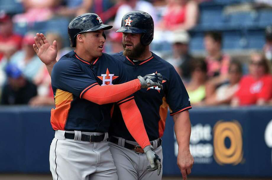 George Springer gets a pat on the back from new teammate Evan Gattis after Springer's third-inning home run off Washington's Doug Fister. Photo: Stacy Revere, Stringer / 2015 Getty Images