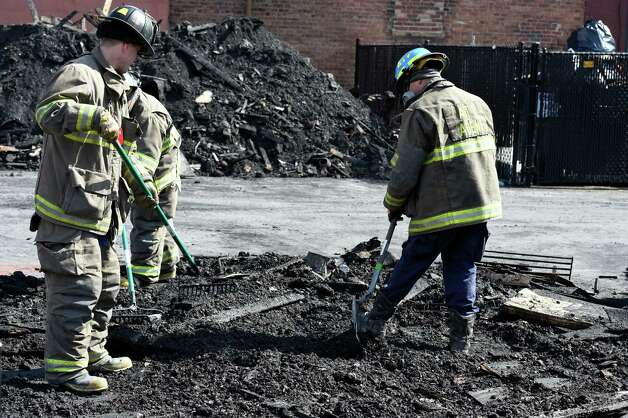 Schenectady firefighters and ATF agents sift through debris from the Jay Street Fire Friday afternoon, March 13, 2015, as they continue their investigation of the fatal that occurred last week in Schenectady, N.Y.   (Skip Dickstein/Times Union) Photo: SKIP DICKSTEIN
