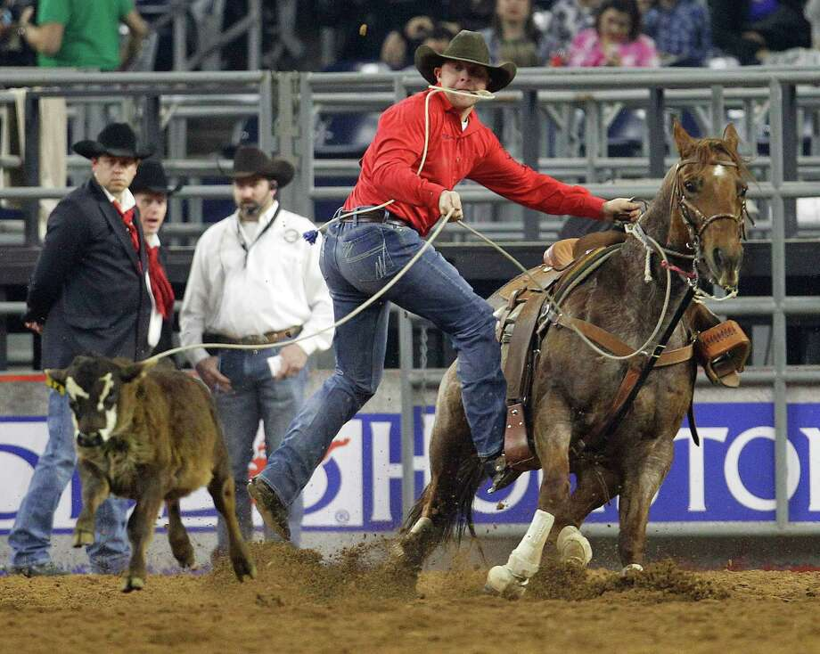 Riley Pruitt competes in the tie-down roping event during the Houston Livestock Show and Rodeo at NRG Stadium, Friday, March 13, 2015, in Houston. Photo: Karen Warren, Houston Chronicle / © 2015 Houston Chronicle