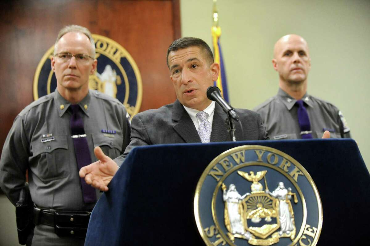 State Police Superintendent Joseph D'Amico, center, flanked by Major Richard Smith, director of training, left, and Deputy Superintendent Francis Christensen, discusses the death of Trooper Donald Fredenburg, 23, on Friday, March 13, 2015, at the State Police Academy in Albany, N.Y. Fredenburg died while on a morning run on the UAlbany campus. (Cindy Schultz / Times Union)