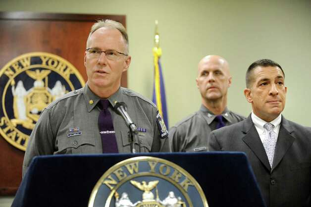 Major Richard Smith, director of training, left, joins Deputy Superintendent Francis Christensen, center, and Superintendent Joseph D'Amico as they discuss the death of Trooper Donald Fredenburg, 23, on Friday, March 13, 2015, at the State Police Academy in Albany, N.Y. Fredenburg died while on a morning run on the UAlbany campus. (Cindy Schultz / Times Union) Photo: Cindy Schultz / 00031030A