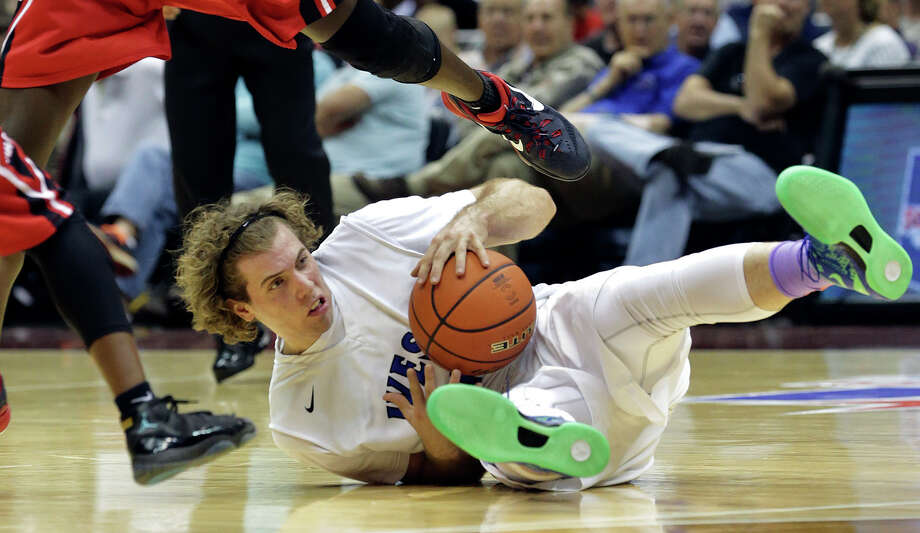 Plano West forward Mickey Mitchell grabs a loose ball and looks for a teammate as his team plays Irving MacArthur in the 6A semifinals of the UIL state basketball tournament at the Alamodome in San Antonio on March 13, 2015. Photo: Tom Reel / San Antonio Express-News