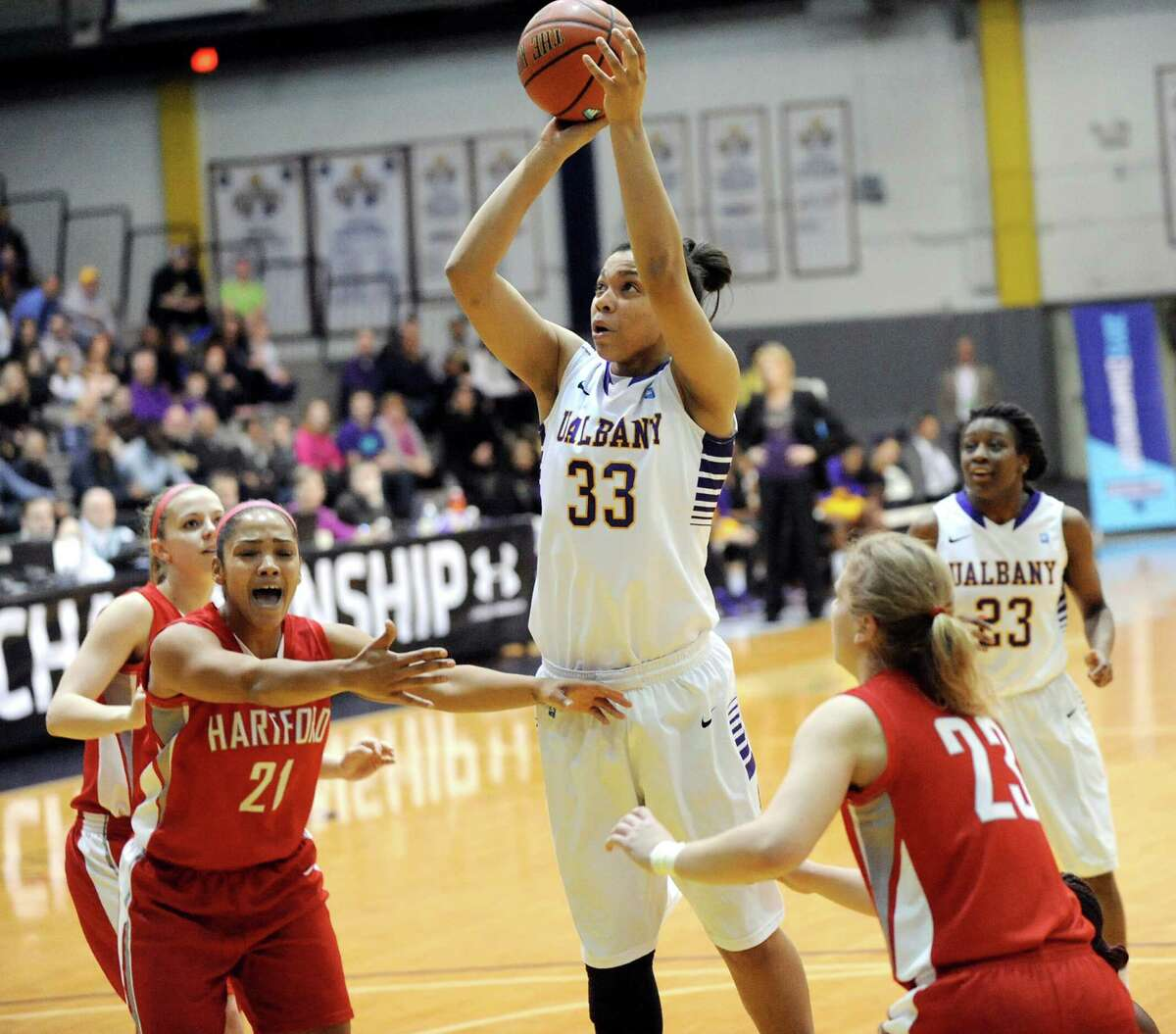 UAlbany's Tiana-Jo Carter, center, goes to the hoop during their America East Championship game against Hartford on Friday, March 13, 2015, at UAlbany in Albany, N.Y. (Cindy Schultz / Times Union)