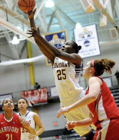 UAlbany's Shereesha Richards, center, goes to the hoop during their America East Championship game against Hartford on Friday, March 13, 2015, at UAlbany in Albany, N.Y. (Cindy Schultz / Times Union) Photo: Cindy Schultz / 00030992A