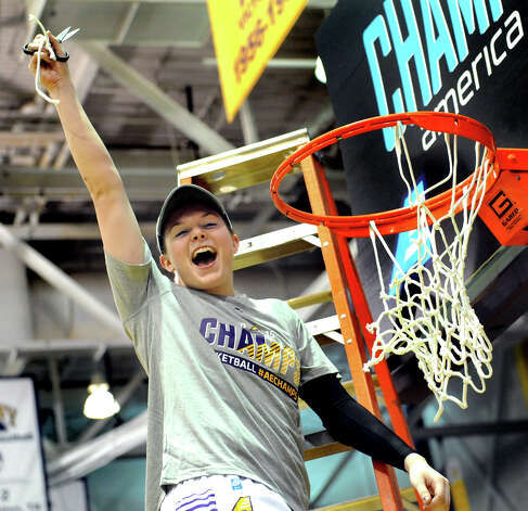 UAlbany's Sarah Royals cuts the net and celebrates her team's 84-75 win over Hartford in their America East Championship game on Friday, March 13, 2015, at UAlbany in Albany, N.Y. (Cindy Schultz / Times Union) Photo: Cindy Schultz / 00030992A