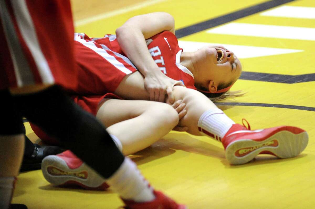 Hartford's Amber Bepko clutches her knee in pain from a game-ending injury during their America East Championship game against UAlbany on Friday, March 13, 2015, at UAlbany in Albany, N.Y. (Cindy Schultz / Times Union)