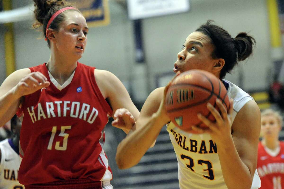 UAlbany's Tiana-Jo Carter, right, looks to shoot as Hartford's Darby Lee defends during their America East Championship game on Friday, March 13, 2015, at UAlbany in Albany, N.Y. (Cindy Schultz / Times Union)