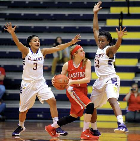 UAlbany's Margarita Rosario, left, and Zakiya Saunders, right, pressure Hartford's Deanna Mayza during their America East Championship game on Friday, March 13, 2015, at UAlbany in Albany, N.Y. (Cindy Schultz / Times Union) Photo: Cindy Schultz / 00030992A