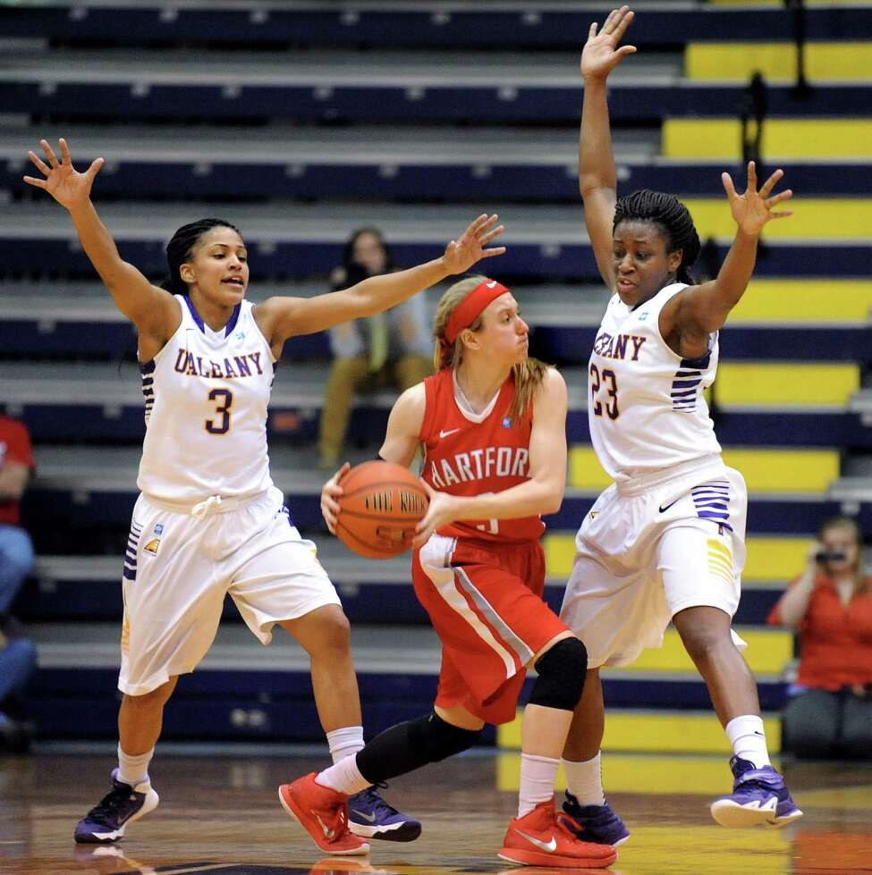 UAlbany's Margarita Rosario, left, and Zakiya Saunders, right, pressure Hartford's Deanna Mayza during their America East Championship game on Friday, March 13, 2015, at UAlbany in Albany, N.Y. (Cindy Schultz / Times Union)