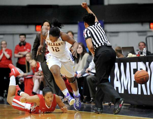 UAlbany's Imani Tate, center, and Hartford's Shanise Bultron, left, fight to keep a ball inbounds during their America East Championship game on Friday, March 13, 2015, at UAlbany in Albany, N.Y. (Cindy Schultz / Times Union) Photo: Cindy Schultz / 00030992A