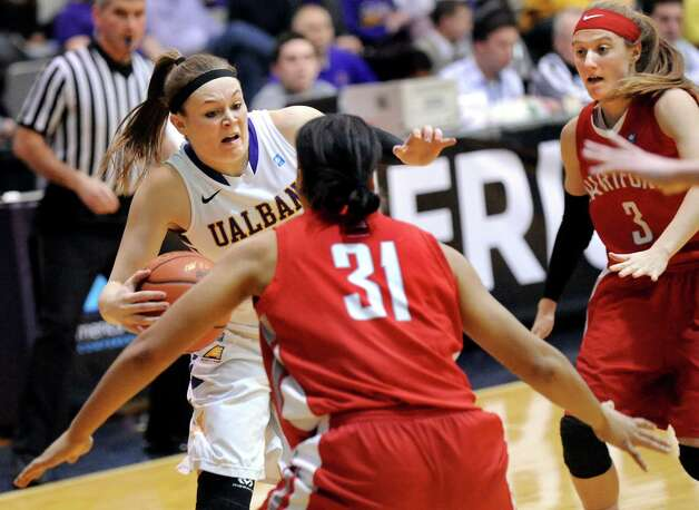 UAlbany's Sarah Royals, left, controls the ball as Hartford's Cherelle Moore, center, and Deanna Mayza defend during their America East Championship game on Friday, March 13, 2015, at UAlbany in Albany, N.Y. (Cindy Schultz / Times Union) Photo: Cindy Schultz / 00030992A