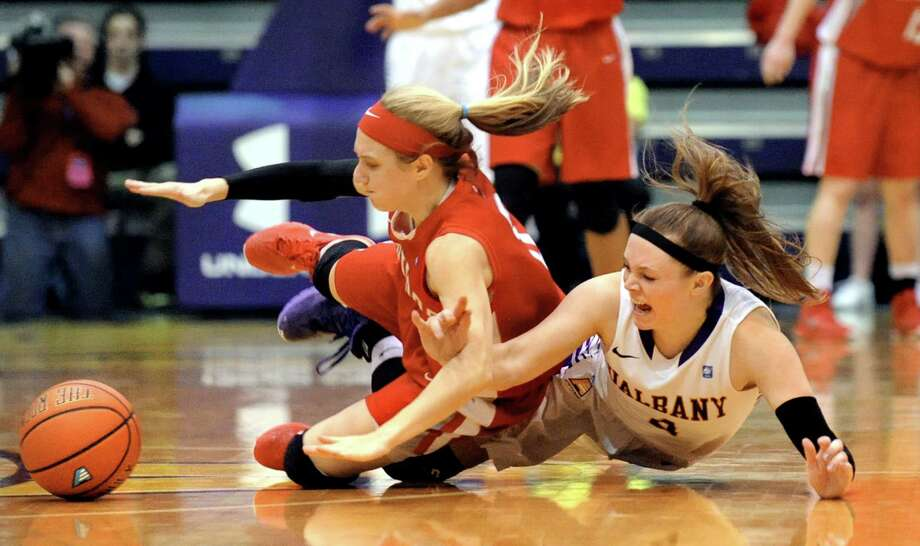 UAlbany's Sarah Royals, right, gets tangled up with Hartford's Deanna Mayza when they chase a loose ball during their America East Championship game on Friday, March 13, 2015, at UAlbany in Albany, N.Y. (Cindy Schultz / Times Union) Photo: Cindy Schultz / 00030992A