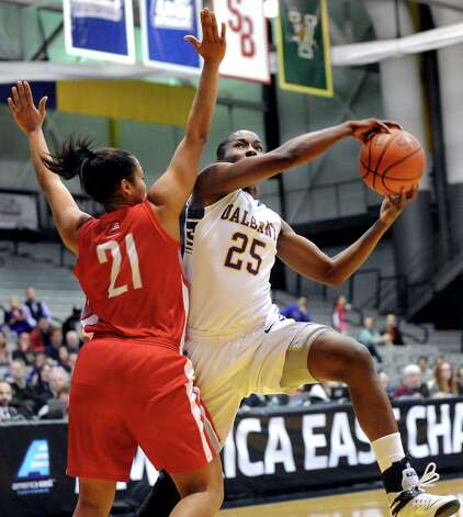 UAlbany's Shereesha Richards, right, goes to the hoop as Hartford's Shanise Bultron defends during their America East Championship game on Friday, March 13, 2015, at UAlbany in Albany, N.Y. (Cindy Schultz / Times Union) Photo: Cindy Schultz / 00030992A