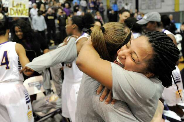 UAlbany's Margarita Rosario, right, embraces Sarah Royals as they celebrate their 84-75 win over Hartford in their America East Championship game on Friday, March 13, 2015, at UAlbany in Albany, N.Y. (Cindy Schultz / Times Union) Photo: Cindy  Schultz / 00030992A