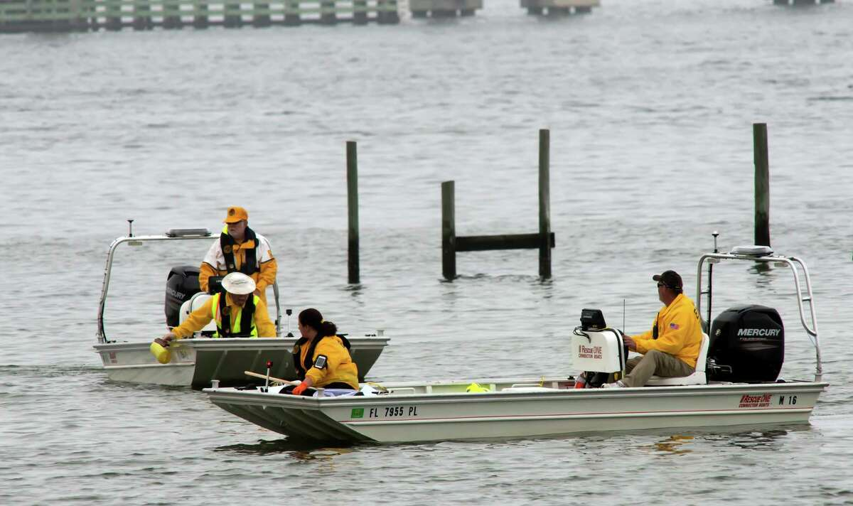 Military and civilian personnel search the waters Wednesday, March 11, 2015 in Navarre, Fla. Searchers struggled Wednesday to find the seven Marines and four soldiers killed when a helicopter crashed, hampered by the same fog that plagued a nighttime training mission. (AP Photo/The Pensacola News Journal, Tony Giberson) NO SALES ORG XMIT: FLPEJ302