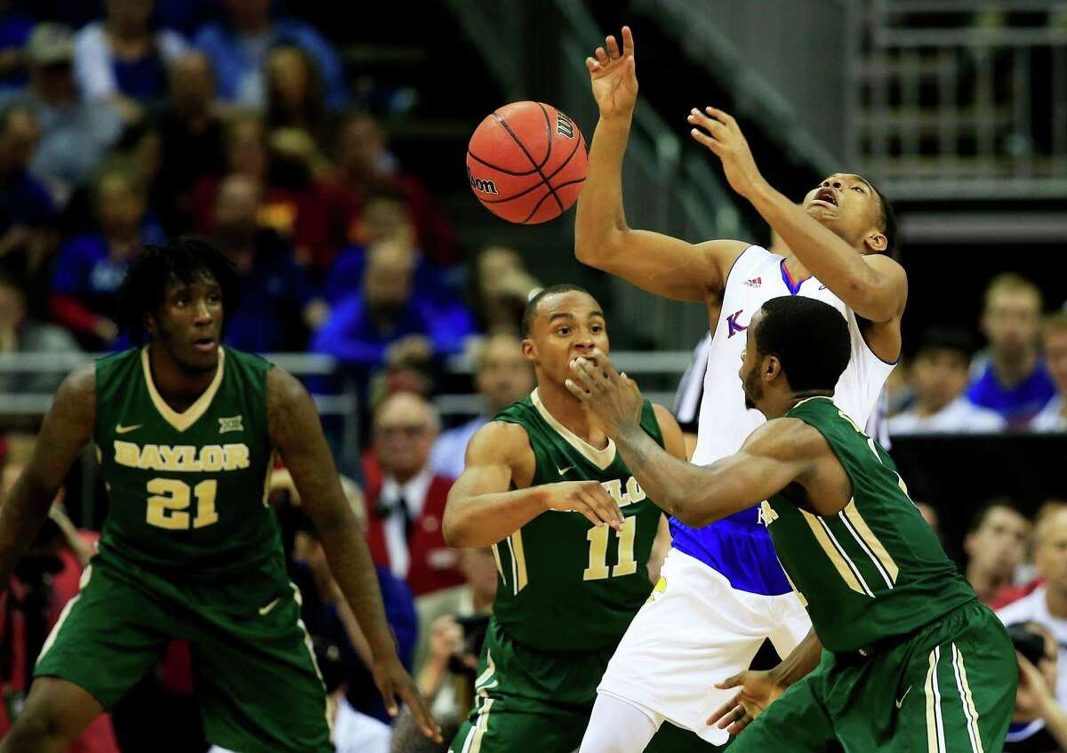 KANSAS CITY, MO - MARCH 13: Devonte Graham #4 of the Kansas Jayhawks looses posession of the ball to Kenny Chery #1 and Lester Medford #11 of the Baylor Bears in the second half during a semifinal game of the 2015 Big 12 Basketball Tournament at Sprint Center on March 13, 2015 in Kansas City, Missouri. (Photo by Jamie Squire/Getty Images)